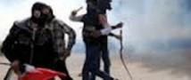 В Каире полиции стреляет по демонстрантам мелкой дробью