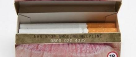 На сигаретные пачки будут наносить ужасающие фото