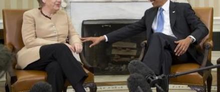 Барак Обама похвалил Меркель и пообещал снять санкции с России