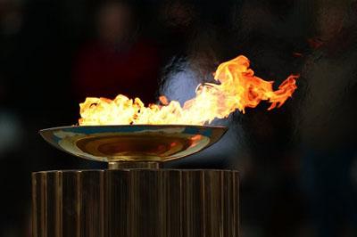 Дед Мороз будет бежать с олимпийским огнём в костюме Олимпийских игр