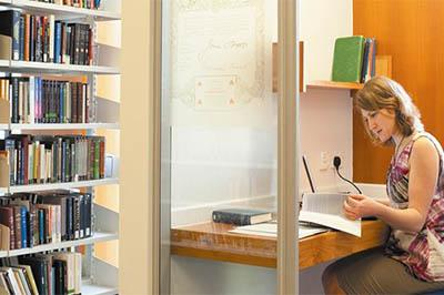 Female-postgraduate-student-studying-in-Hallward-Library,-University-Park-Cropped-714x335