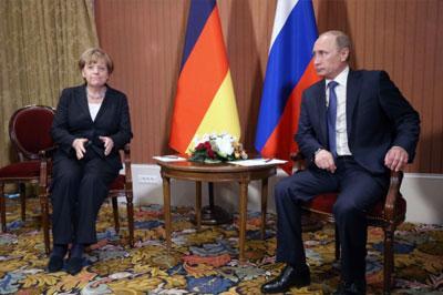 Путин и Меркель встретились за закрытыми дверями