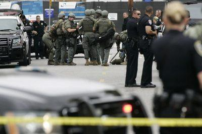 Police officers gather during a search at Santa Monica College following a shooting on campus in Santa Monica, California