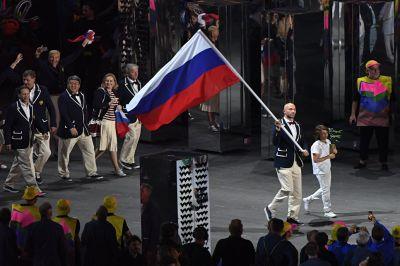Бегун Вандерлей Кордейру, завоевавший бронзу в Афинах в 2004 году, зажег огонь XXXI летней Олимпиады - игры стартовали.